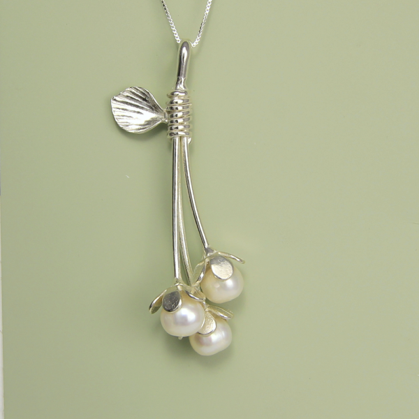 """Graceful Long Bud Necklace One of a kind Graceful Long Bud Necklace created individually by artist Lori Strickland. Each piece will vary slightly. Beautiful freshwater pearl are the budding flowers on this elegant necklace. Stunning piece hangs on 18"""" sterling silver box chain. Necklace includes storycard, artist bio and imprinted gift box"""